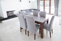 Wooden table in elegant interior Stock Images