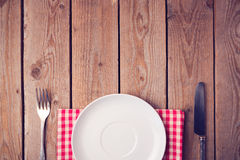 Wooden table with empty plate. View from above Royalty Free Stock Photography