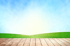 Wooden table with environmental on grassland field. Stock Photos