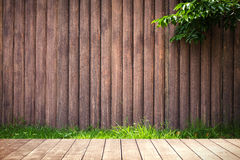 Wooden table with environmental on wood grunge wall texture. Royalty Free Stock Photography
