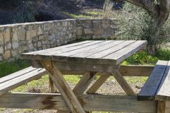 Wooden table in the field for picnic. Rustic wooden picnic table in a rural setting Royalty Free Stock Photography