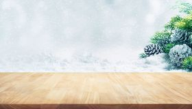 Wooden table on fir tree,pine cones,snowfall.Christmas ornament. Decoration idea background concepts stock image