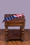 Wooden table with flag Royalty Free Stock Photos