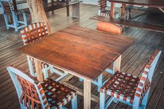Wooden table and four chairs - empty restaurant stock image