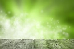 Wooden table of free space and green background stock photo