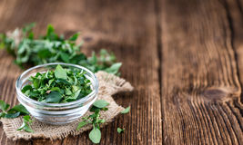 Wooden Table with fresh Menthol leaves Stock Photo