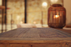 wooden table in front of abstract living room background royalty free stock image