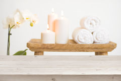 Wooden table in front of blurred background of spa products.  stock images