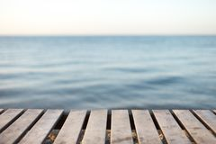 Wooden table in front of blurred sea background. For present your products. Summer Concept Stock Photo