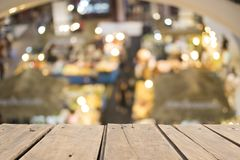Wooden table on front blurred supermarket background. Copy space stock photography