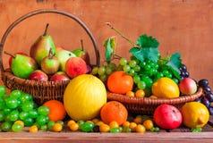 Wooden table full fresh fruit baskets Stock Photo