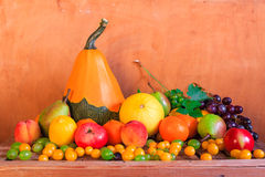 Wooden table full fresh fruit baskets Royalty Free Stock Photography