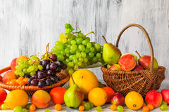 Wooden table full fresh fruit baskets Stock Images