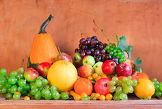 Wooden table full fresh fruit baskets Royalty Free Stock Photos
