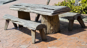 Wooden Table in Garden. Garden wooden table and chairs Royalty Free Stock Image