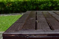 Wooden table in the garden stock photo