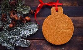 Christmas gingerbread and green spruce branches stock images