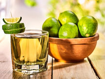 On wooden table is glass with green transparent drink. Royalty Free Stock Images