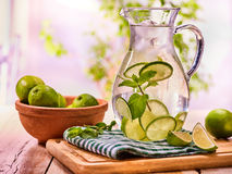 On wooden table is glass jug with transparent drink. Stock Photography
