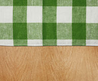 Wooden table with green gingham tablecloth Royalty Free Stock Photo