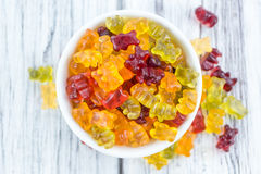 Wooden table with Gummy Bears selective focus Royalty Free Stock Photo