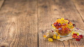 Wooden table with Gummy Bears (selective focus) Royalty Free Stock Photos