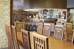 Wooden table in hall for beer taste in Ochakovo Royalty Free Stock Images