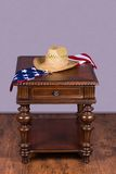 Wooden table with hat and flag Stock Photos