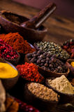 Wooden table of hot spices Stock Photography