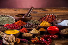 Wooden table of hot spices Stock Images