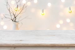 Free Wooden Table In Front Of Blurred Abstract Winter Holiday Background Royalty Free Stock Image - 126713806