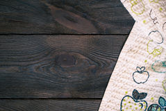 Wooden table with kitchen towel Stock Images