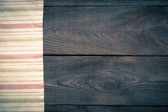 Wooden table with kitchen towel. Background for recipes Stock Images