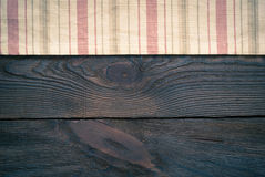 Wooden table with kitchen towel Royalty Free Stock Images
