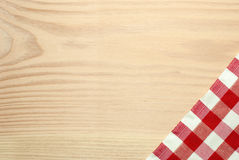 Wooden table label with checked red textile Royalty Free Stock Image