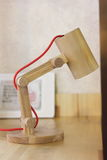 wooden table lamp made by hand Royalty Free Stock Photography