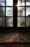 Wooden table with large window stock photos
