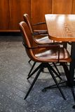 Wooden table and leather chairs or chairs, in a cafe, office or room. Stylish design, vintage style. Space for Breakfast, business. Meetings and corporate royalty free stock image