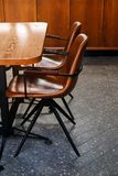 Wooden table and leather chairs or chairs, in a cafe, office or room. Stylish design, vintage style. Space for Breakfast, business. Meetings and corporate royalty free stock photo