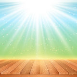 Wooden table looking out to starburst sky Royalty Free Stock Photography
