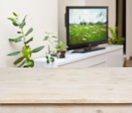 Wooden table on lounge room interior background.  Royalty Free Stock Image