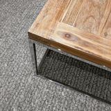 Modern wooden table on gray knitted carpet Royalty Free Stock Image