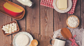Wooden table with milk and cheese products. Healthy eating concept. Place for text. View from above. Stock Photos