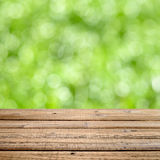 Wooden table with natural bokeh Royalty Free Stock Photo
