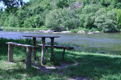 The wooden table on the nature near the river Royalty Free Stock Images