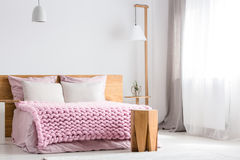 Wooden table next to bed Stock Images