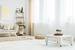 Wooden table next to windows stock image