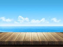 Wooden table with ocean landscape in background Royalty Free Stock Images