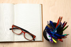 Wooden table with office supplies, top view.  stock photography