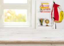 Wooden table over blurred background of junior schoolchild room interior.  Royalty Free Stock Photography